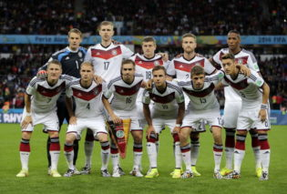 The German national team pose before the World Cup round of 16 soccer match between Germany and Algeria at the Estadio Beira-Rio in Porto Alegre, Brazil, Monday, June 30, 2014. (AP Photo/Matthias Schrader)